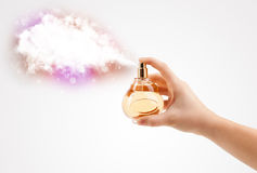 Woman hands spraying colorful cloud Royalty Free Stock Photos