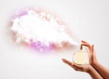 Woman hands spraying colorful cloud Stock Photos