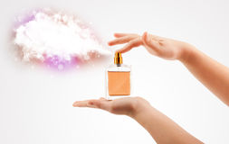 Woman hands spraying colorful cloud Stock Images