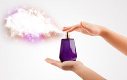 Woman hands spraying colorful cloud Stock Image