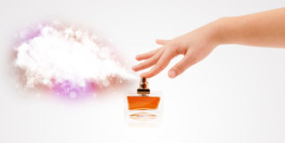 Woman hands spraying colorful cloud Stock Photos