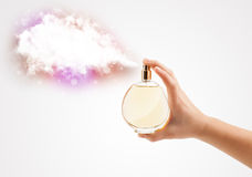 Woman hands spraying colorful cloud Royalty Free Stock Photo