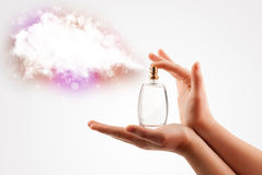 Woman hands spraying colorful cloud Stock Photo