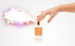 Woman hands spraying colorful cloud Royalty Free Stock Images