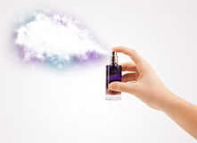 Woman hands spraying colorful cloud Royalty Free Stock Photography