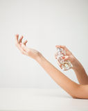 Woman hands spraying perfume Royalty Free Stock Photography