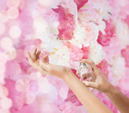 Woman hands spraying perfume. Cosmetics, body parts and beauty concept - close up of woman hands spraying perfume Stock Photos