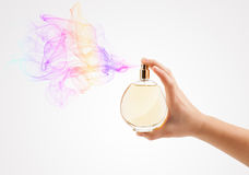 Woman hands spraying perfume. Close up of woman hands spraying perfume Royalty Free Stock Photography