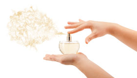 Woman hands spraying perfume Stock Photography