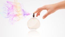 Woman hands spraying perfume Royalty Free Stock Photo