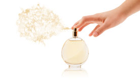 Woman hands spraying perfume Royalty Free Stock Image