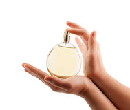 Woman hands spraying perfume Stock Photos