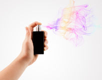 Woman hands spraying perfume Stock Photos