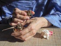 Woman hands spraying perfume on her wrist. Oriental woman gets the perfume oil on her wrists. Oriental woman gets the perfume oil on her wrists Royalty Free Stock Image