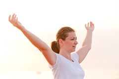 Woman with hands spread apart enjoys Stock Photos