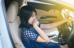 Woman hands squeeze and touching her nose with of bad smell in a car stock photo