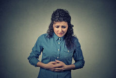 Woman hands on stomach having bad aches pain Royalty Free Stock Photography