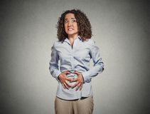 Woman hands on stomach having bad aches pain Royalty Free Stock Images
