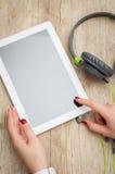 Woman hands tablet headphones Stock Images