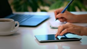 Woman hands with tablet PC and notepad Stock Photo