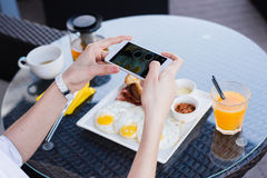 Woman hands taking food photo by mobile phone. Food photography. Delicious breakfast. stock image