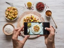 Woman hands taking phone photo of food. Woman hands taking phone photo of food royalty free stock photo