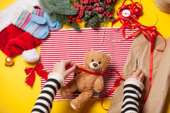 Woman hands and teddy bear toy Royalty Free Stock Photos