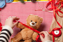 Woman hands and teddy bear toy Stock Images