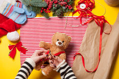 Woman hands and teddy bear toy Royalty Free Stock Photo