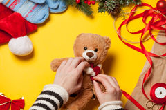 Woman hands and teddy bear toy Royalty Free Stock Images