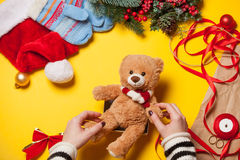Woman hands and teddy bear toy Royalty Free Stock Photography