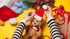 Woman hands and teddy bear toy Stock Photo
