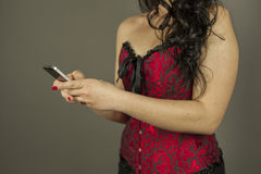 Woman hands texting a message on the phone stock photos