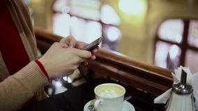 Woman hands texting, using smartphone in cafe. stock footage