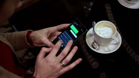 Woman hands texting, using smartphone in cafe. stock video footage