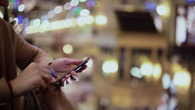 Woman hands texting, using smartphone in mall. stock video