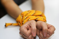 Woman hands tied with rope. Stock Images