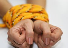 Woman hands tied with rope. Stock Photography