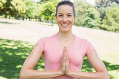 Woman with hands together exercising at park Royalty Free Stock Images