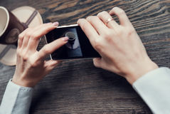 Woman hands with touch screen smartphone Royalty Free Stock Photo