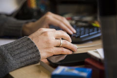 Woman Hands Touching Mouse and Keyboard on Table Royalty Free Stock Photo