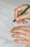 The woman hands tracing the sewing drawing Royalty Free Stock Photo