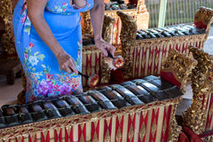 Woman hands and Traditional Balinese music instrument gamelan. Bali island, Indonesia. Royalty Free Stock Photography