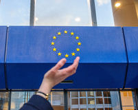 Woman hands trying to hold the stars of European Union insignia Royalty Free Stock Photo
