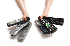 Woman hands with tv controls. Woman hands with tv remote controls. Isolated on white Stock Photos