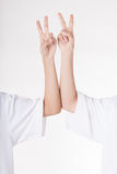 Woman hands. Two women's hand with two fingers up isolated on white Royalty Free Stock Image