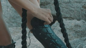 Woman hands tying shoelaces stock video