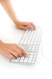 Woman hands typing Stock Image