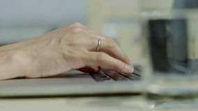 Woman hands typing. Close up of woman hands typing on a laptop outdoors stock video