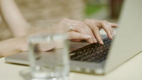 Woman hands typing. Close up of woman hands typing on a laptop outdoors stock video footage